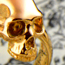 Golden skull ring